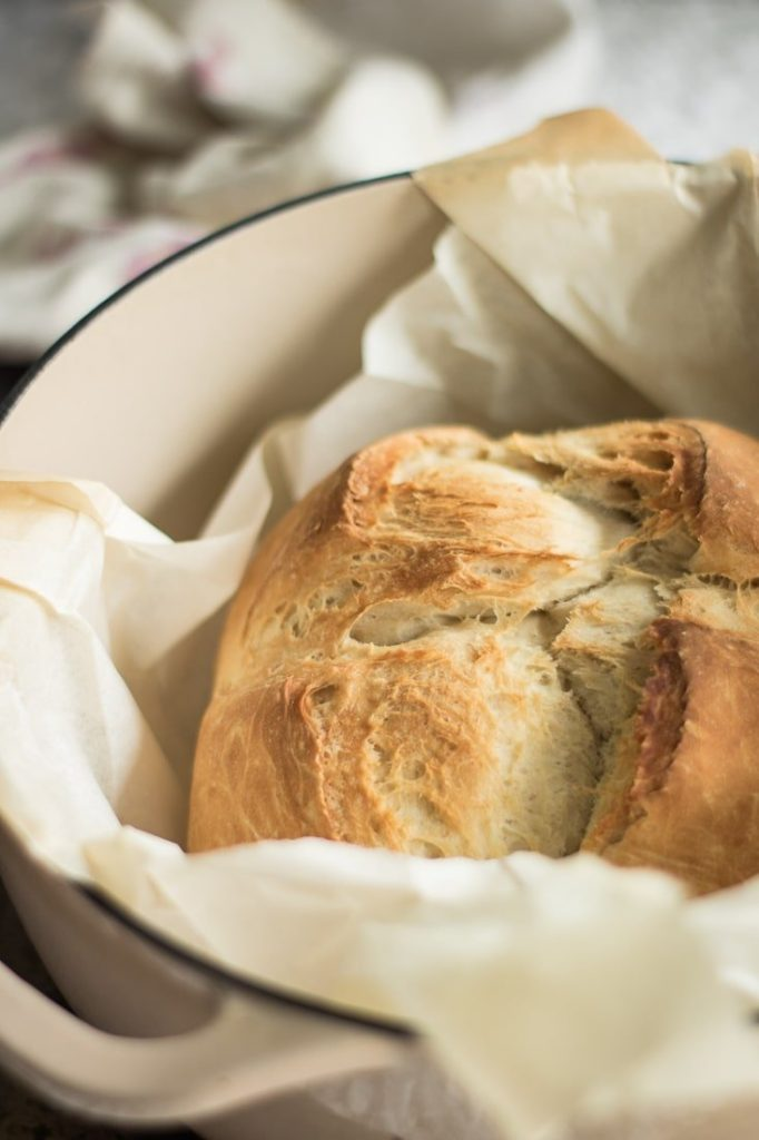 beer bread inside dutch oven, baked, with parchement paper