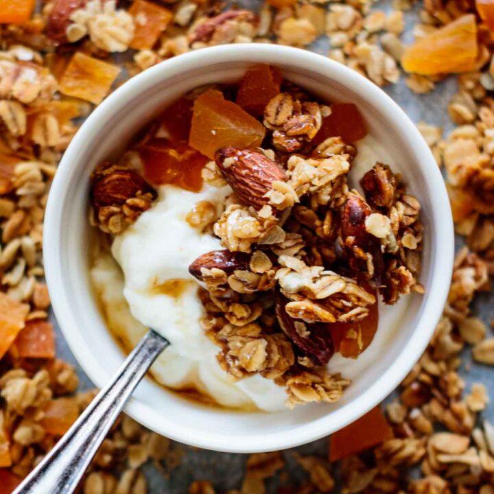 a white bowl of yogurt and granola