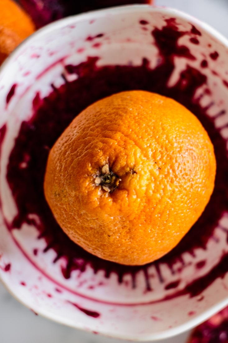 blood orange being juiced