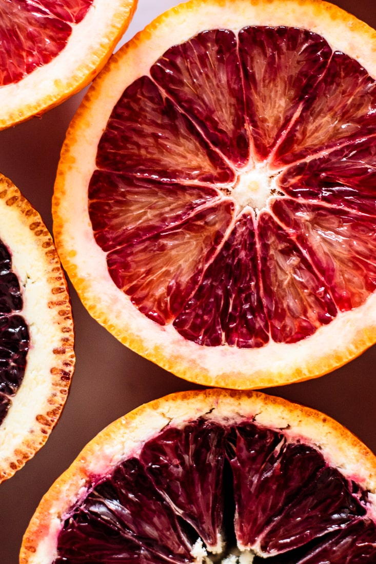 close up of blood oranges halves