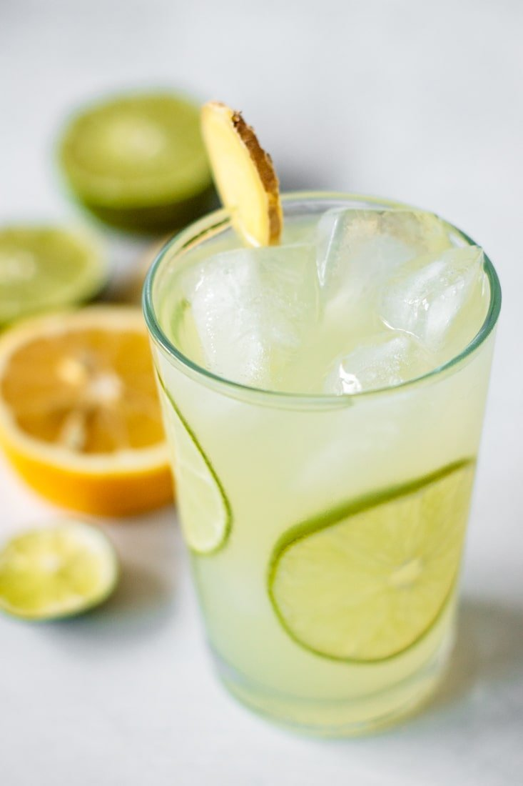 Drink with slices of lime and ginger.