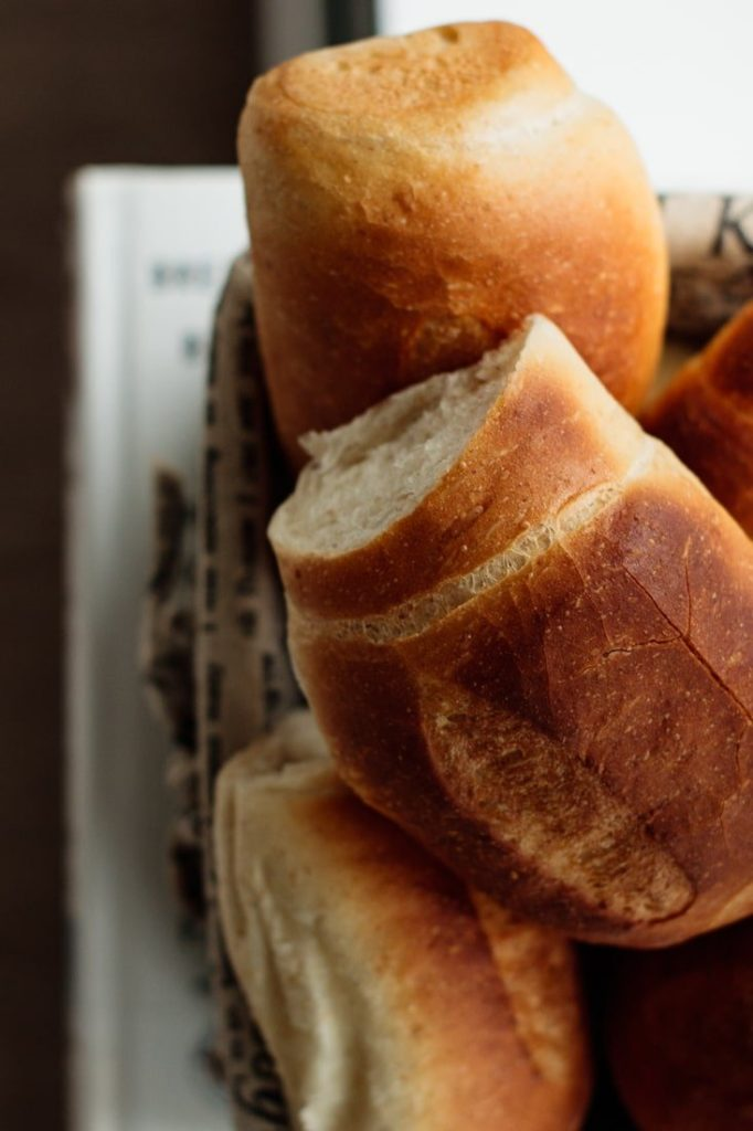 basket full of bread, close up on a golden brown crust