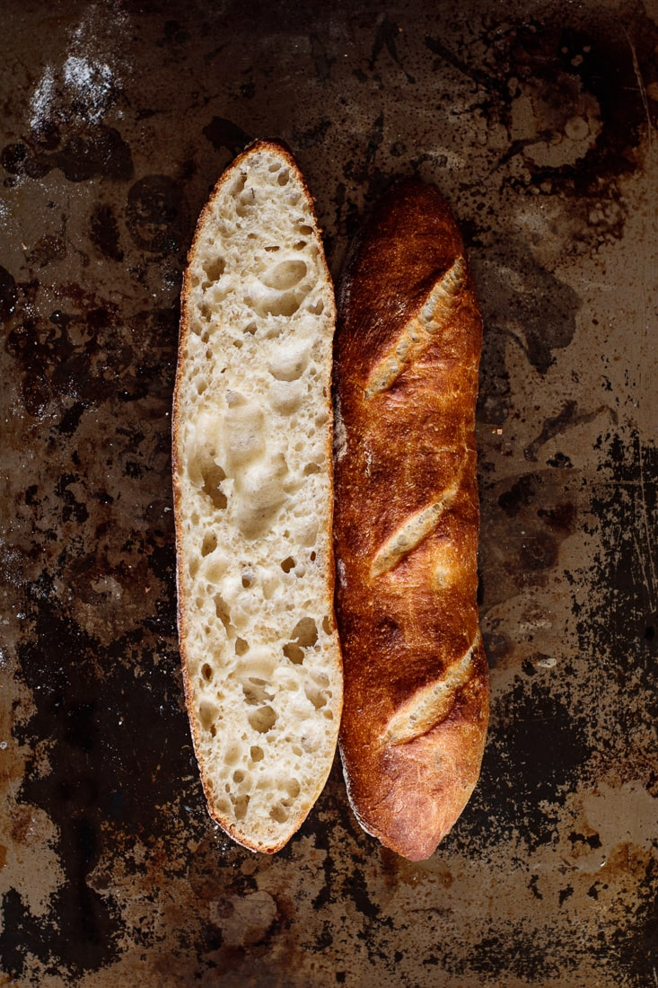 Baguette sliced showing its crumb.