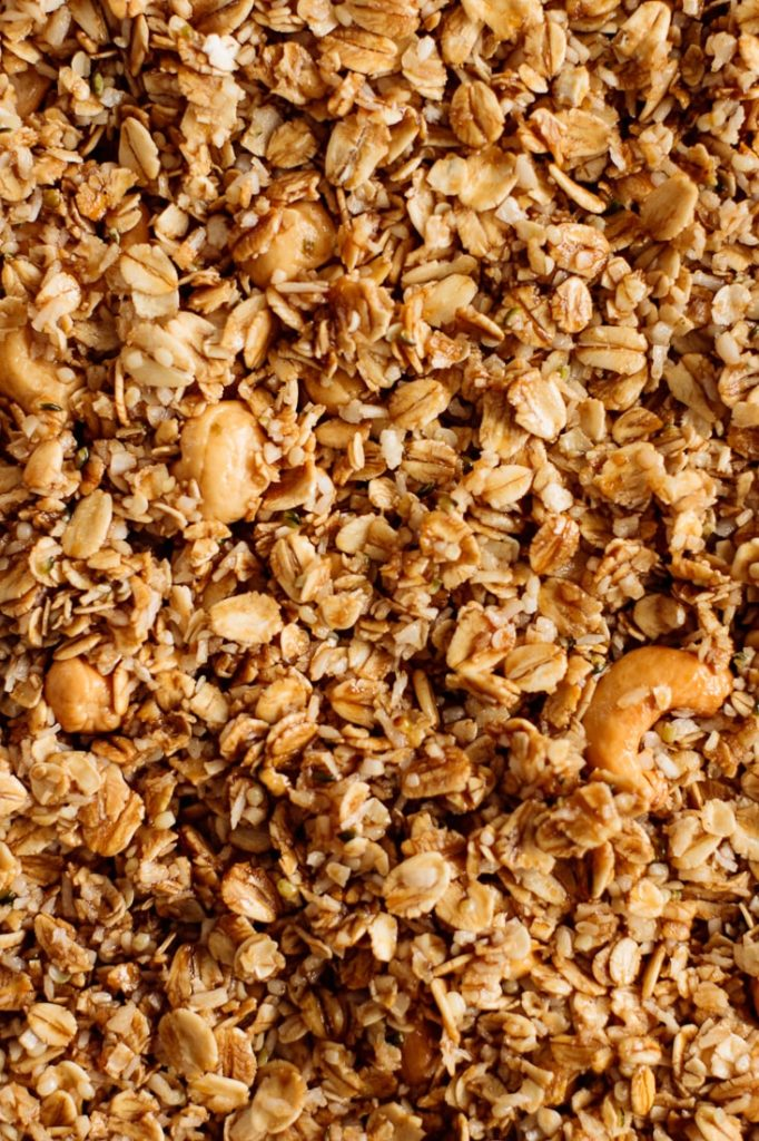 granola ingredients mixed ready to be baked