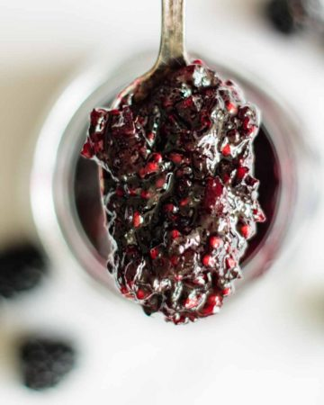 a spoon full of blackberry jam