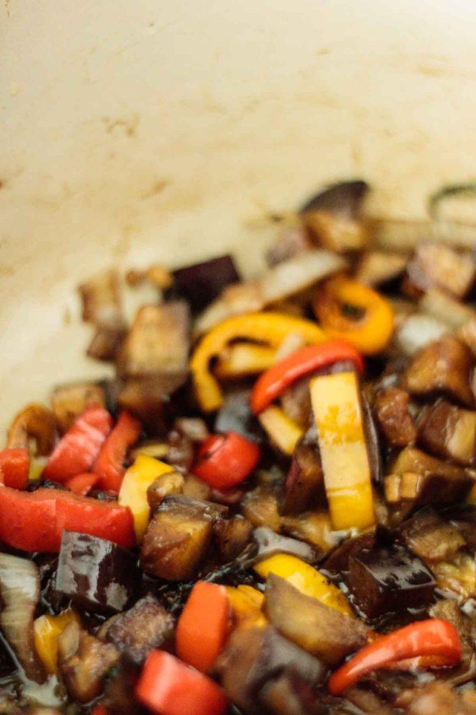 caponata cooking on pan
