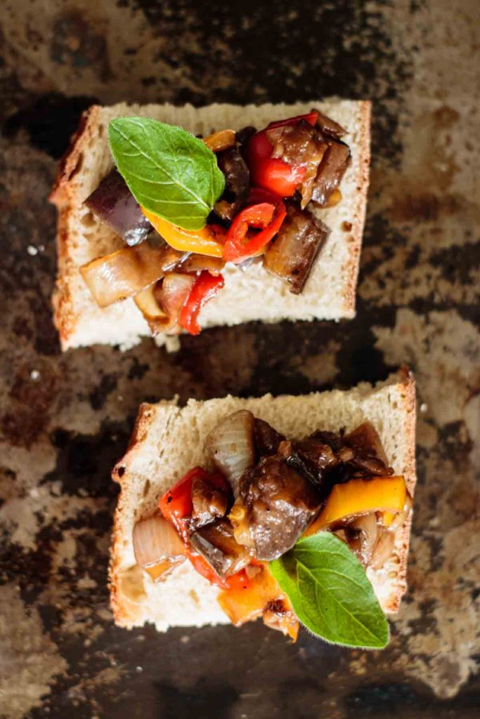 flat lay of two toasts topped with caponata