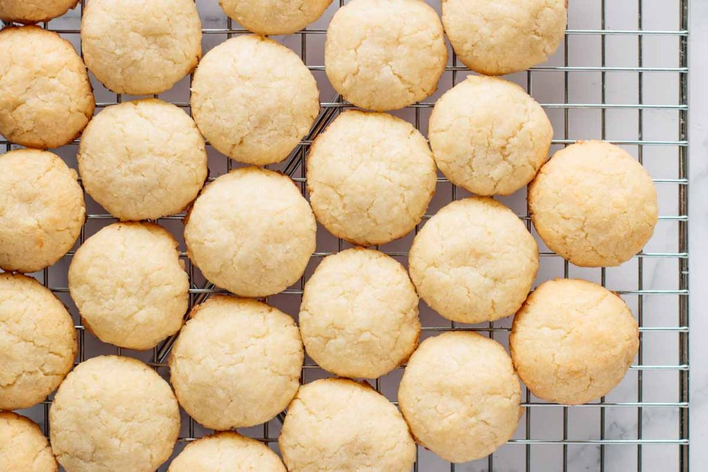 fresh baked cookies on cooling rack seen from above