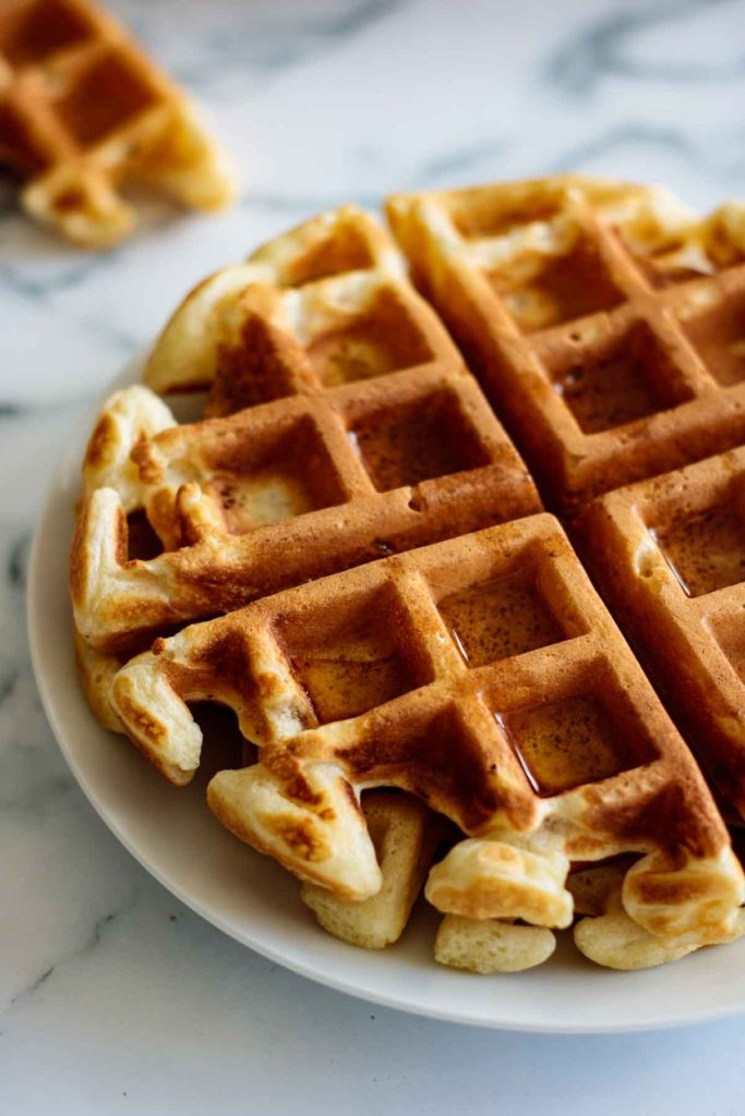 plate with waffles and maple syrup
