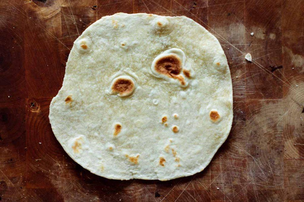 one single sourdough tortilla over wooden board