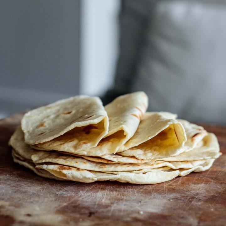 a stack of sourdough tortillas