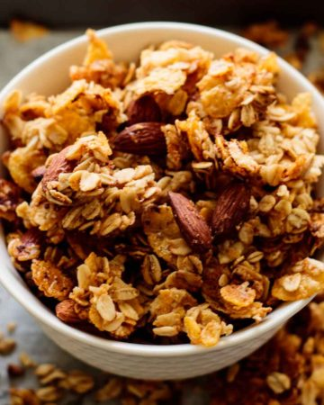 white bowl full of baked cornflakes cereal granola