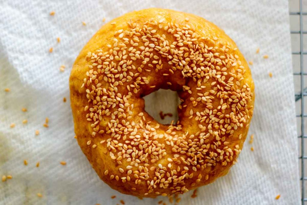 pumpkin bagel just after boiled with sesame seeds on top