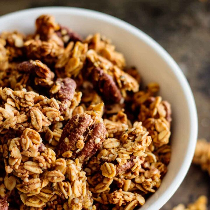 a with bowl of baked pumpkin spice granola