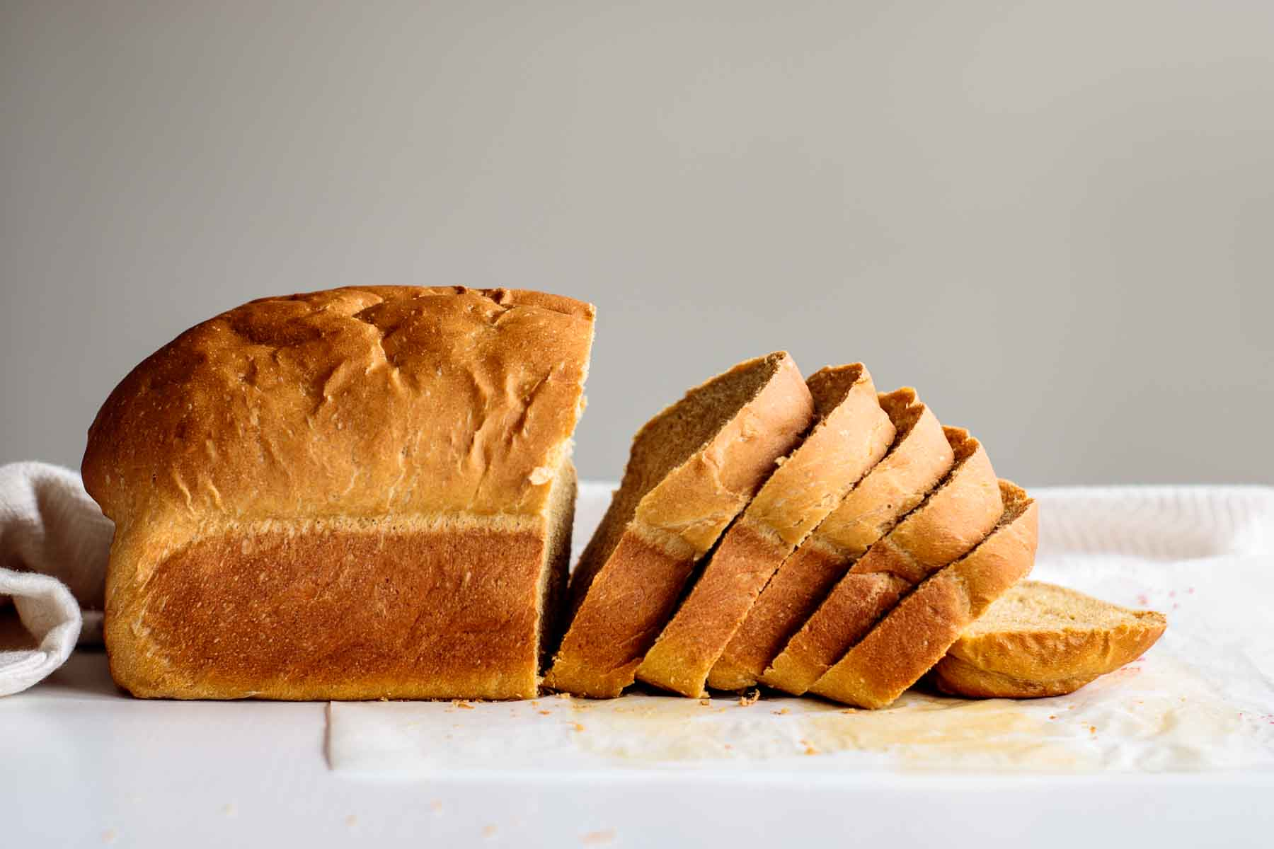 dairy free bread sliced, on top of a white table
