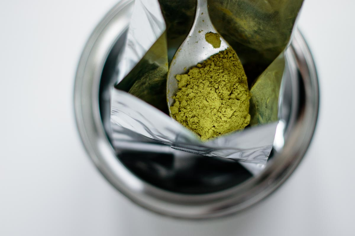 close up on spoon with matcha powder