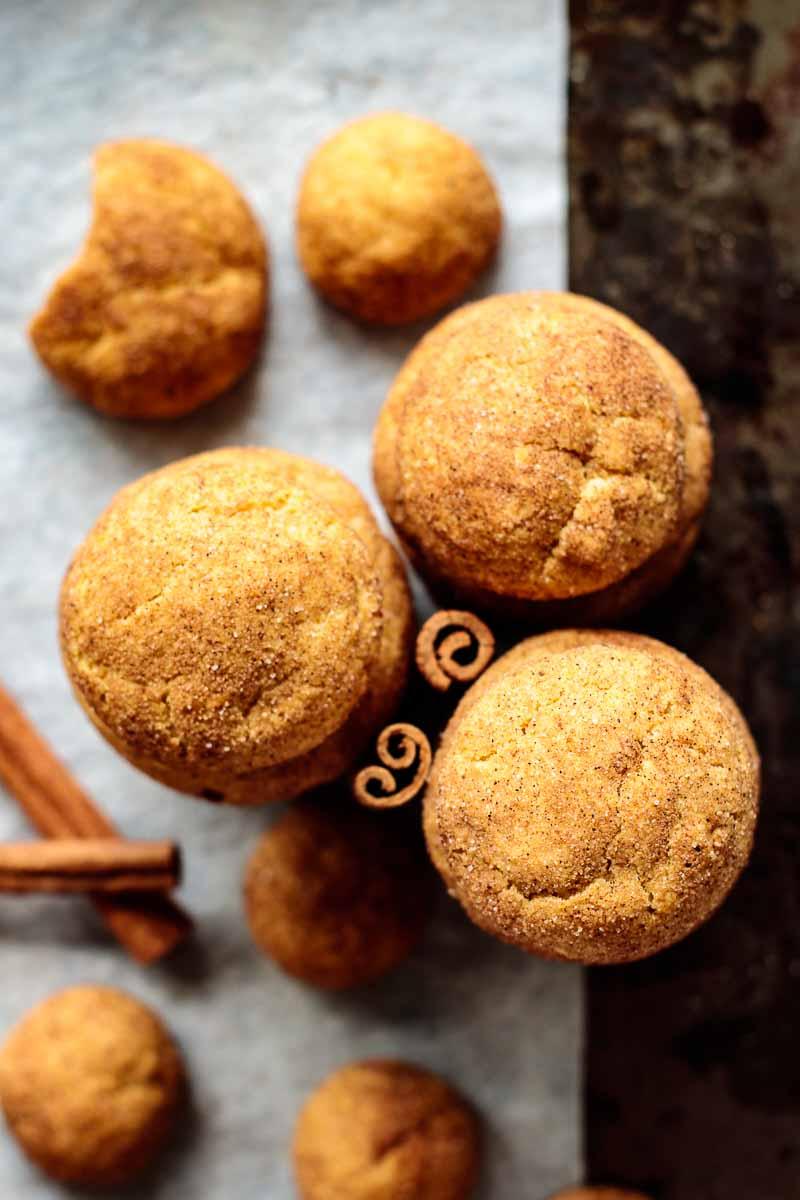 close up on pumpkin snickerdoodles with cinnamon sticks