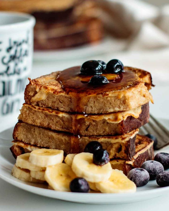 sourdough french toast with butter, berries, bananas and maple syrup