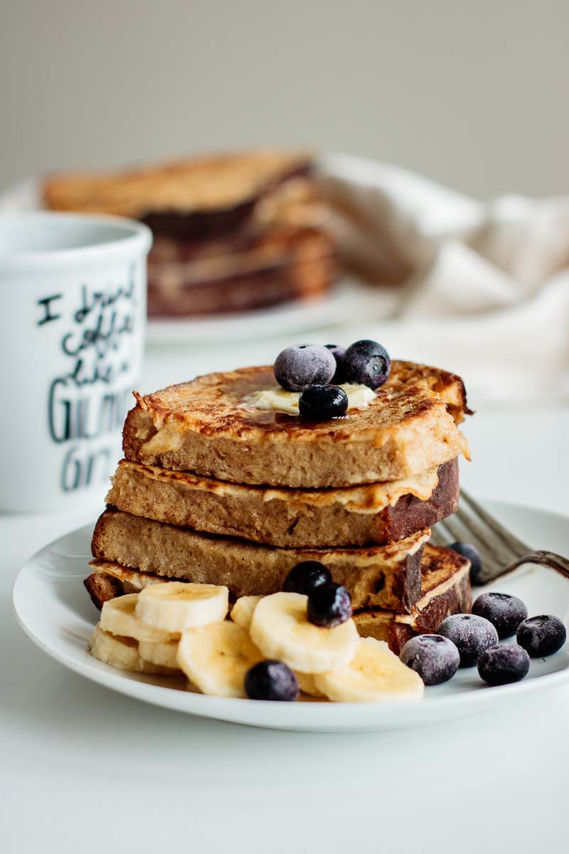 sourdough french toast with butter, berries, and banana