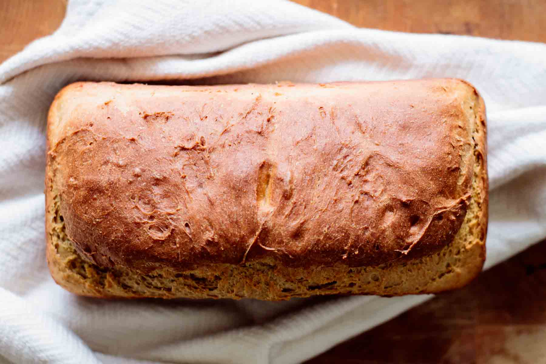 bread resting on a kitchen towel