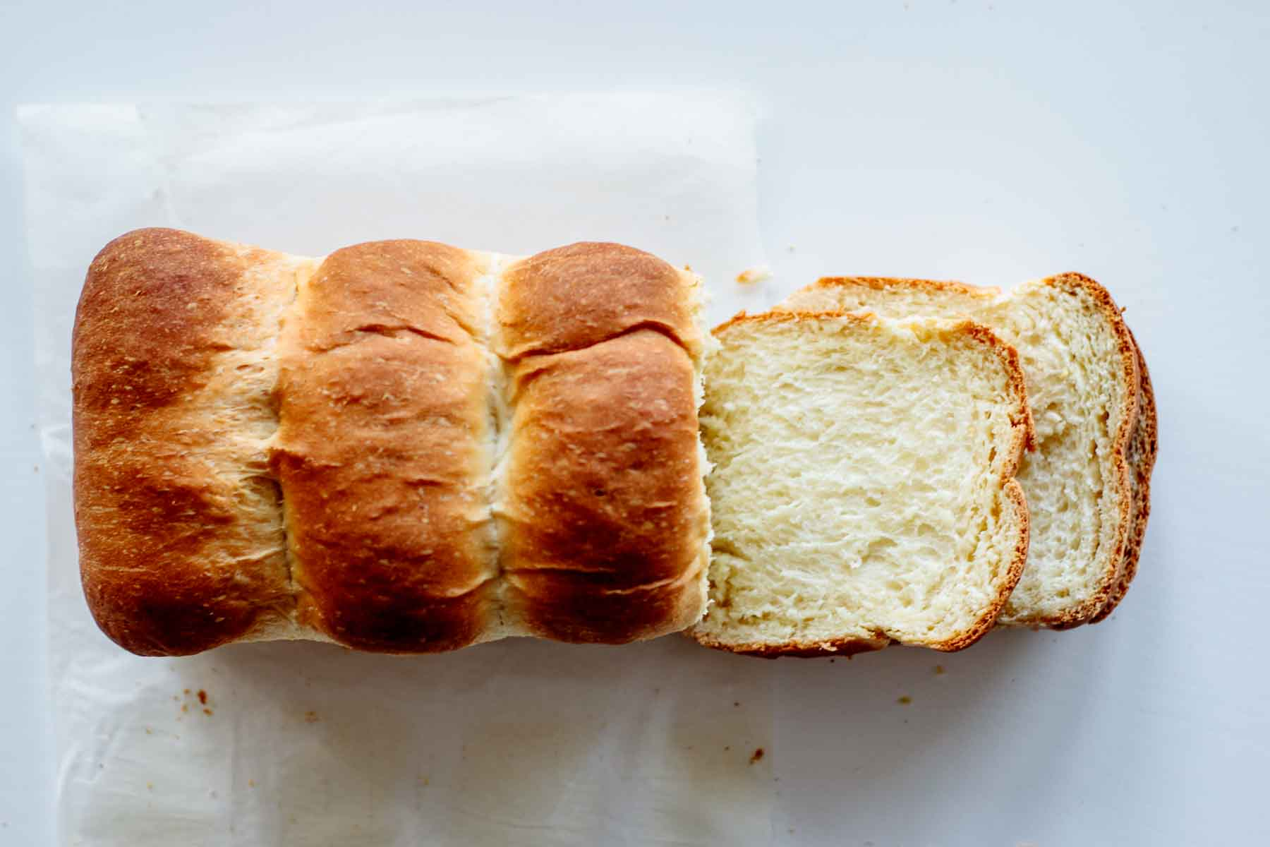 bread sliced photographed from above on a white table
