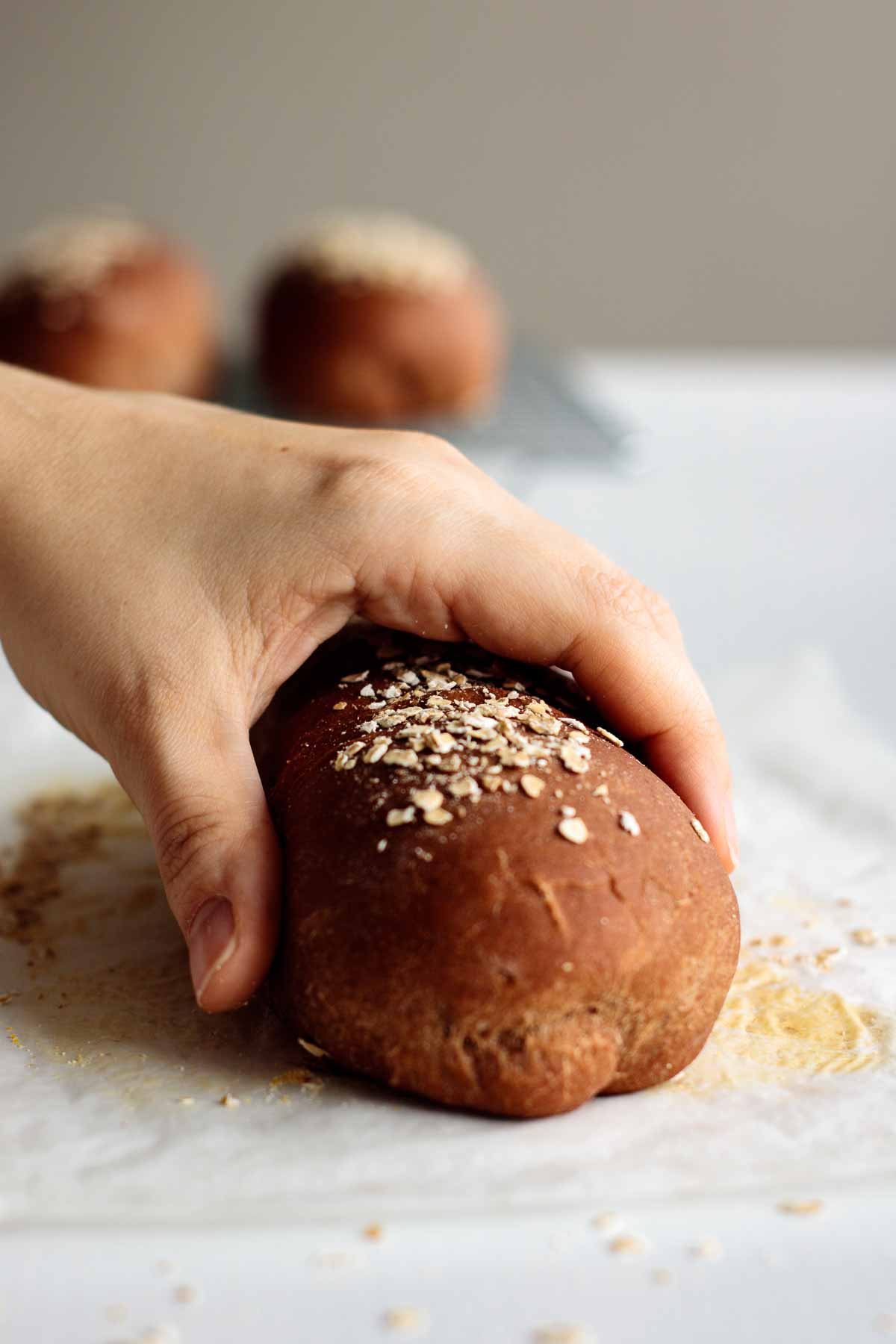 hand holding brown baked bread