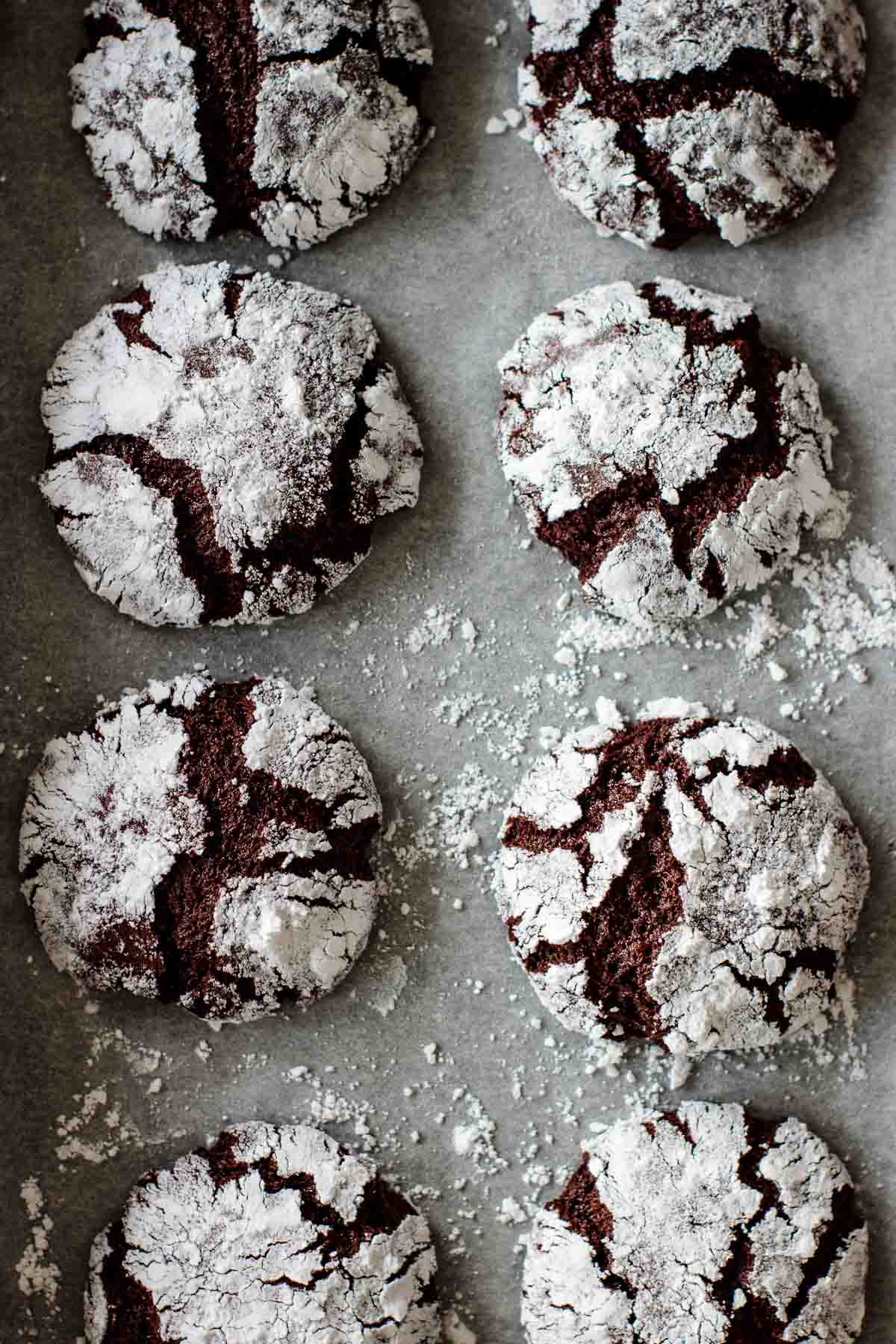 a baking sheet full of chocolate crinkles