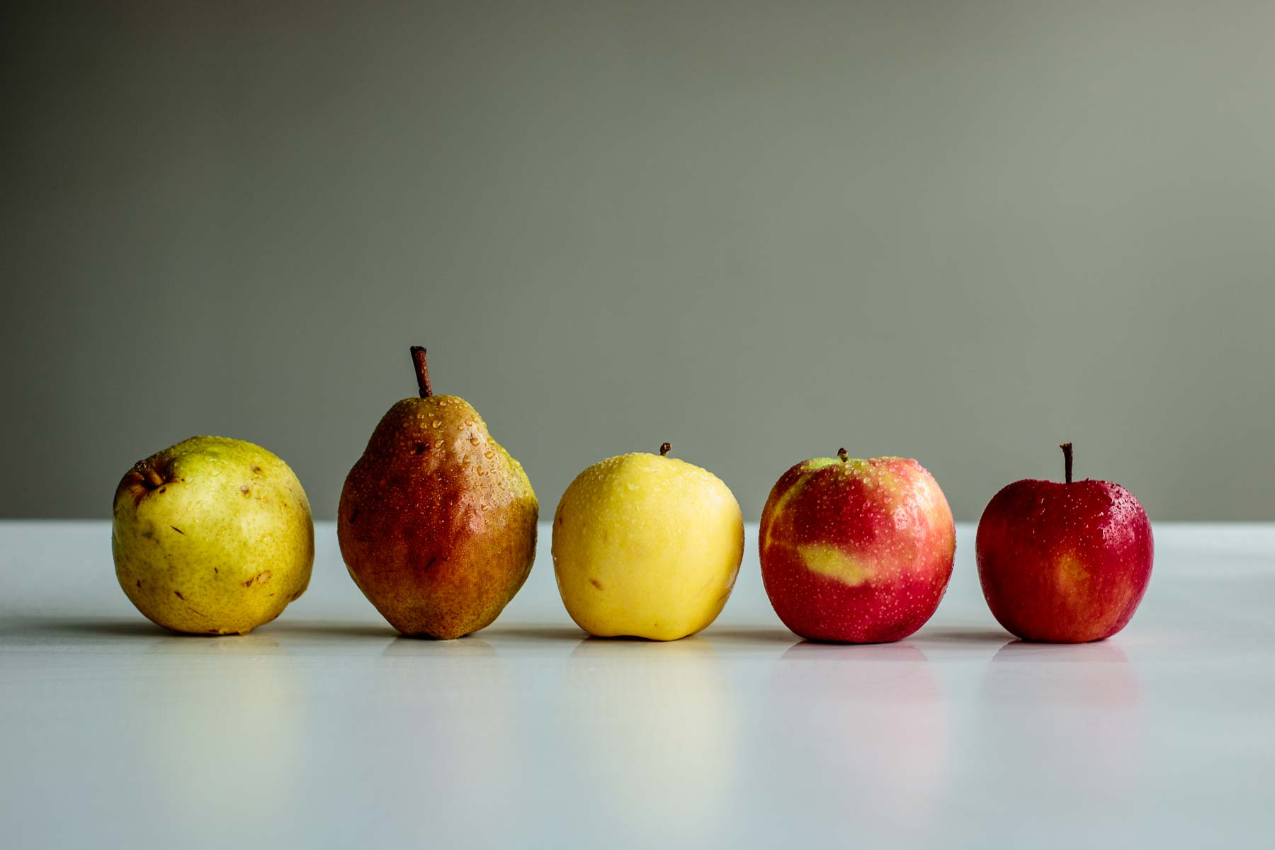 a line of pears and apples