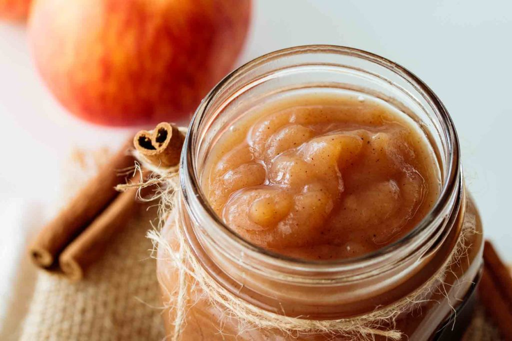 apple butter stored inside a glass jar