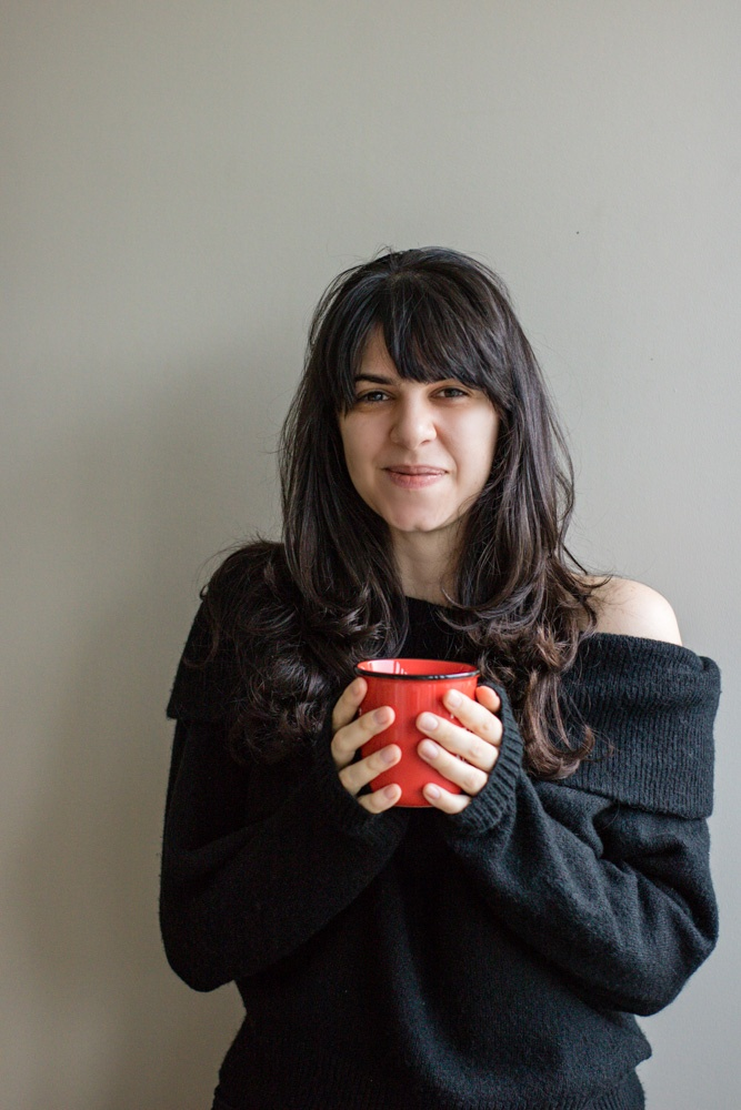 tatiana holding a mug and smiling