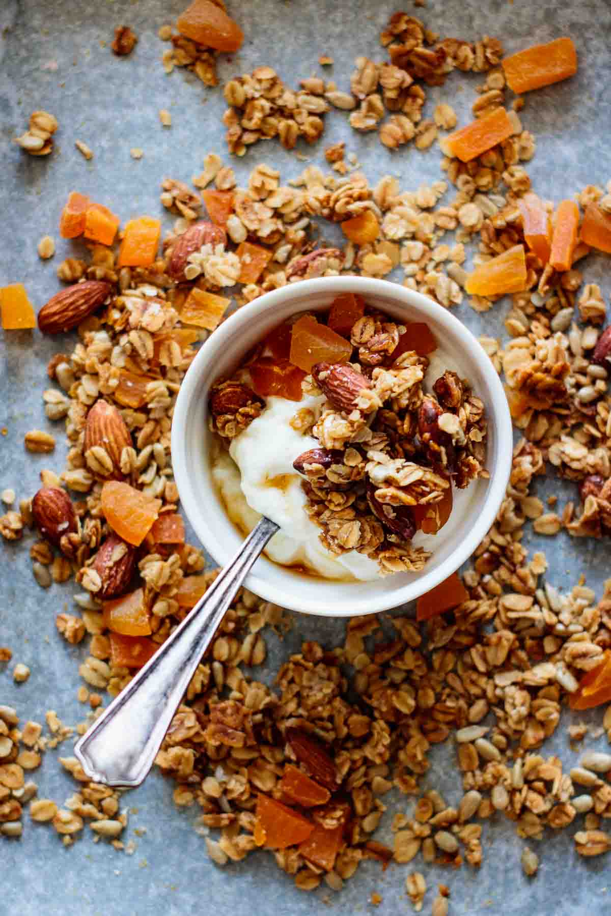 A bowl with granola, dried apricots and yogurt