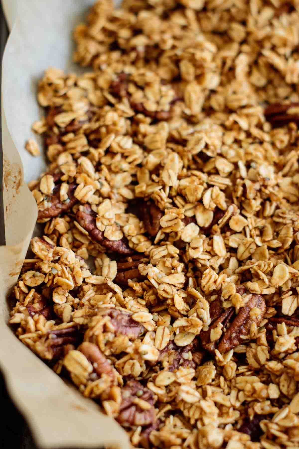 pumpkin granola before baked in a lined sheet