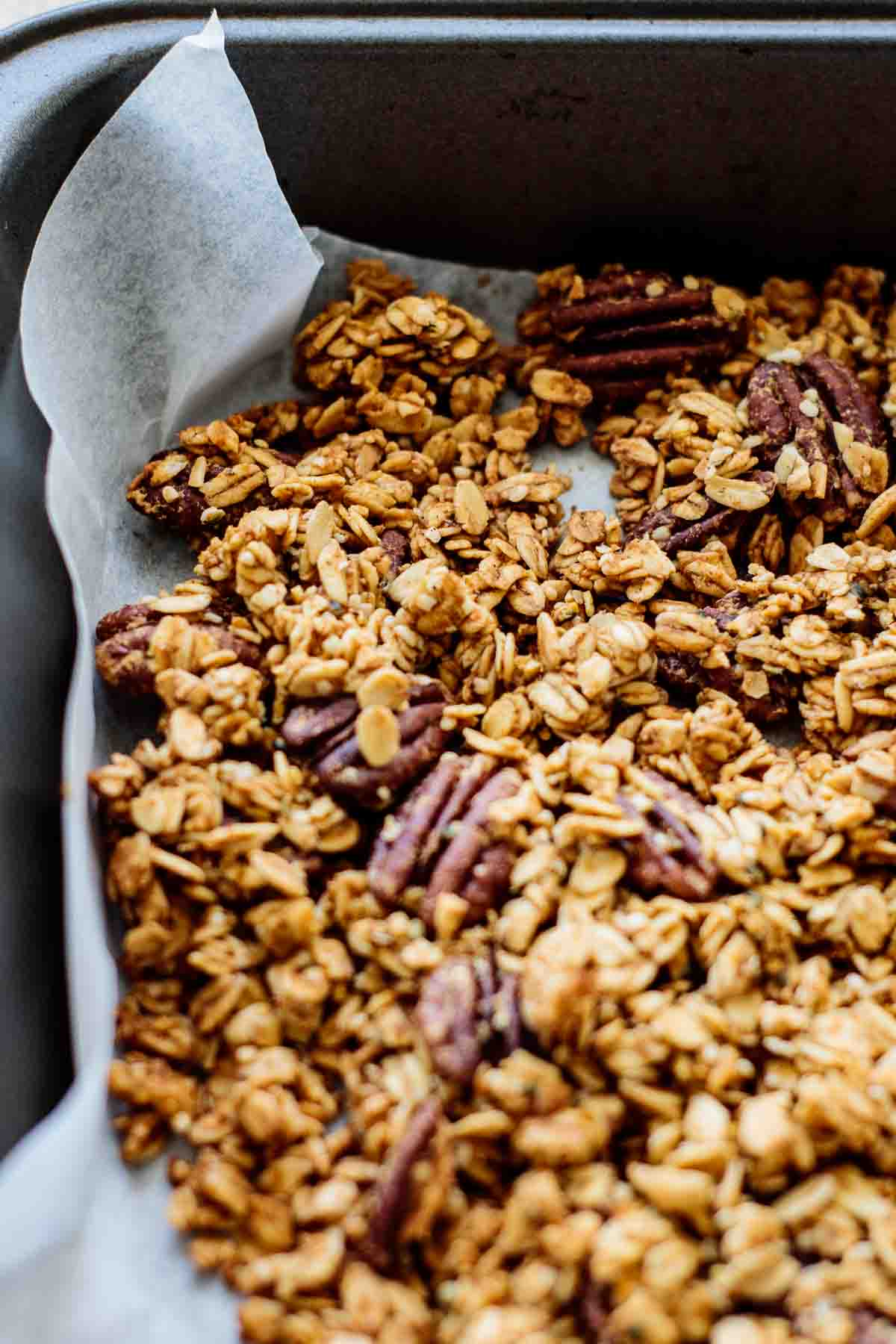 pumpkin granola after baked in a lined sheet