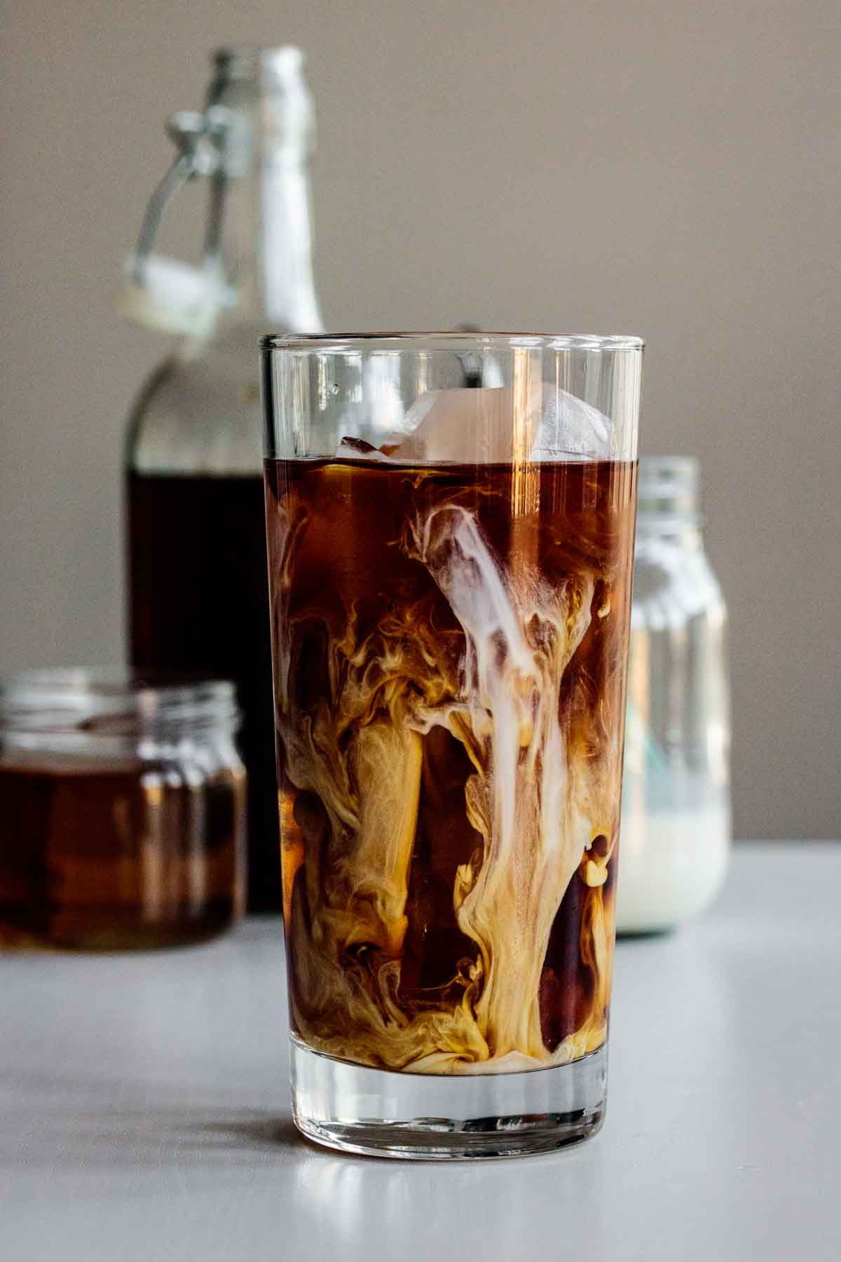 a vanilla sweet cream cold brew just made, on tall glass over ice