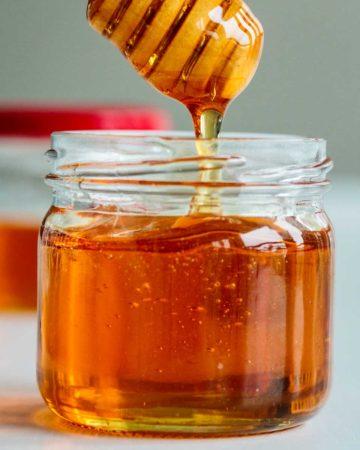 vegan honey dripping off a honey dripper