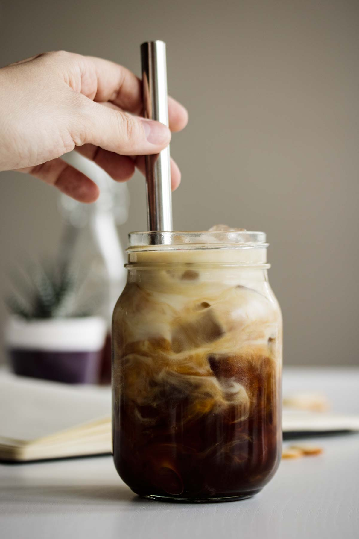 Iced Brown Sugar Oatmilk Shaken Espresso Recipe server in a mason jar.