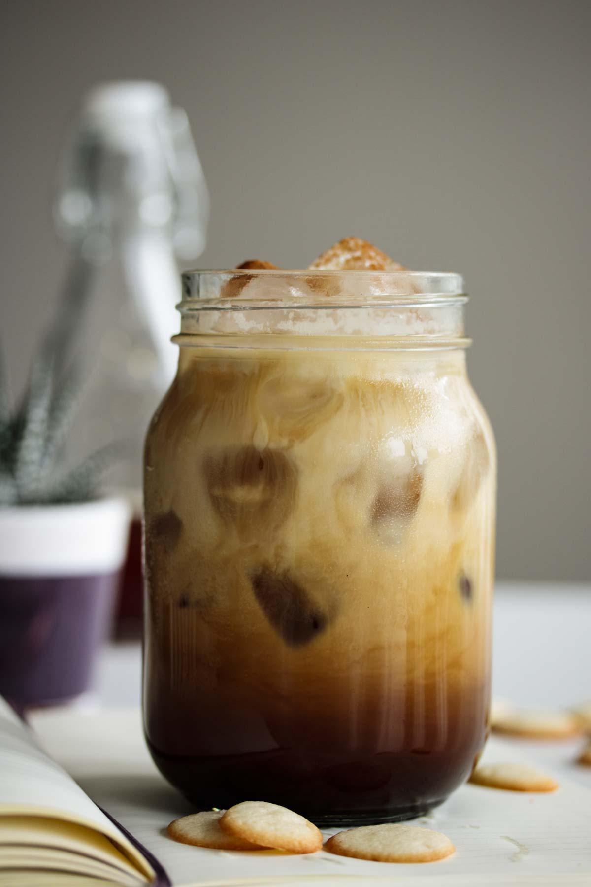 Starbucks copycat iced brown sugar oatmilk shaken espresso ready to drink, served in a mason jar.