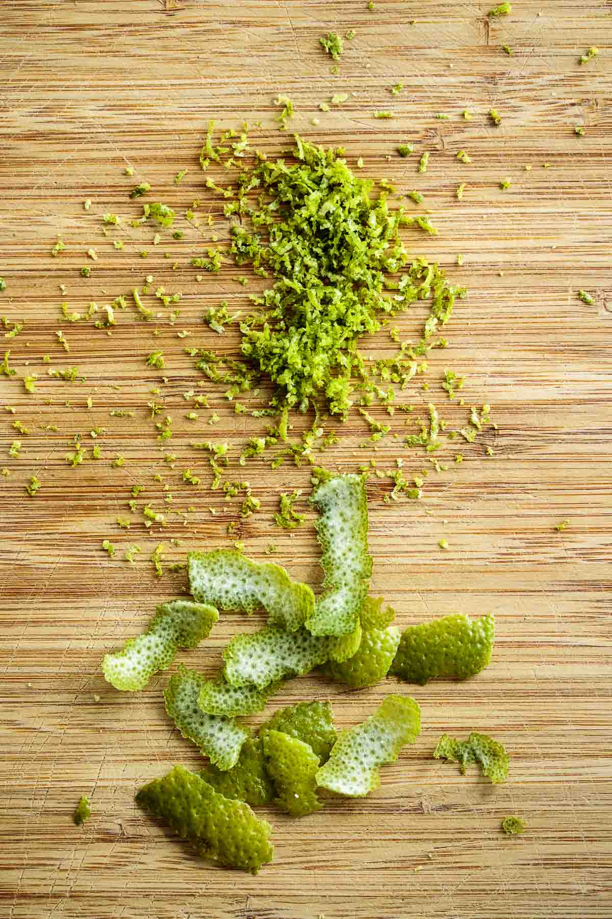 Lime zest, using the grating method and the peeling method.