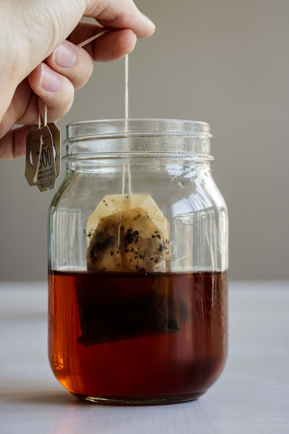 Tea bags being removed from cold brew tea.