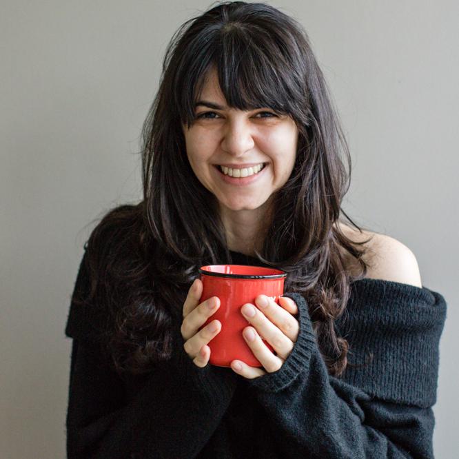 Headshot of Tati holding a mug
