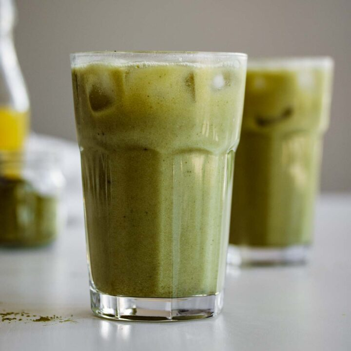 Two glasses of pineapple matcha drink.