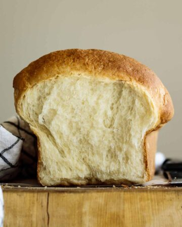 Vegan brioche bun sliced showing its crumb.